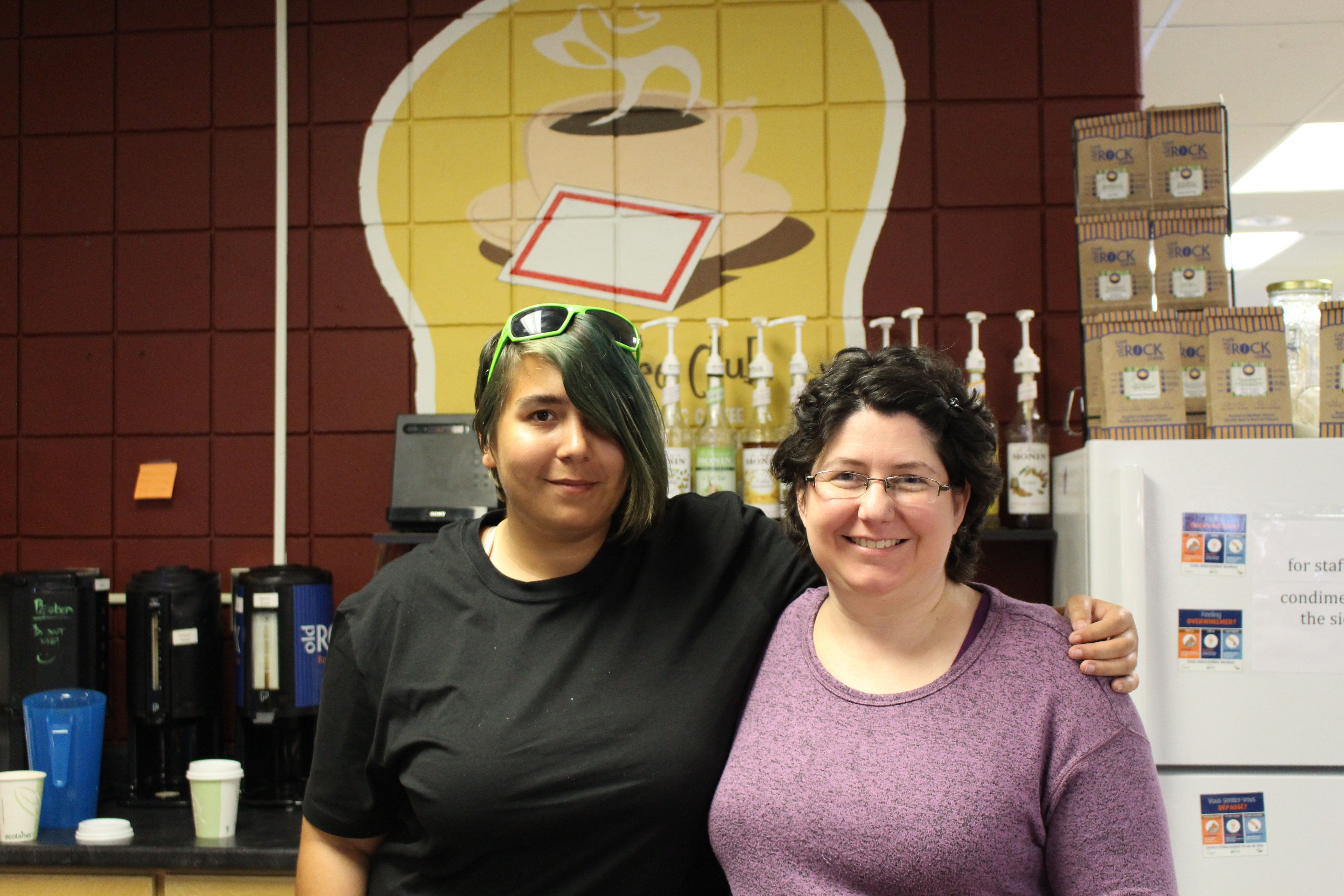 (From left) Tara Ward, Voyageur Cafe employee, and Lizette Frappier, Student Centre Manager, stand in the original cafe. Photo by Kayla Perry.