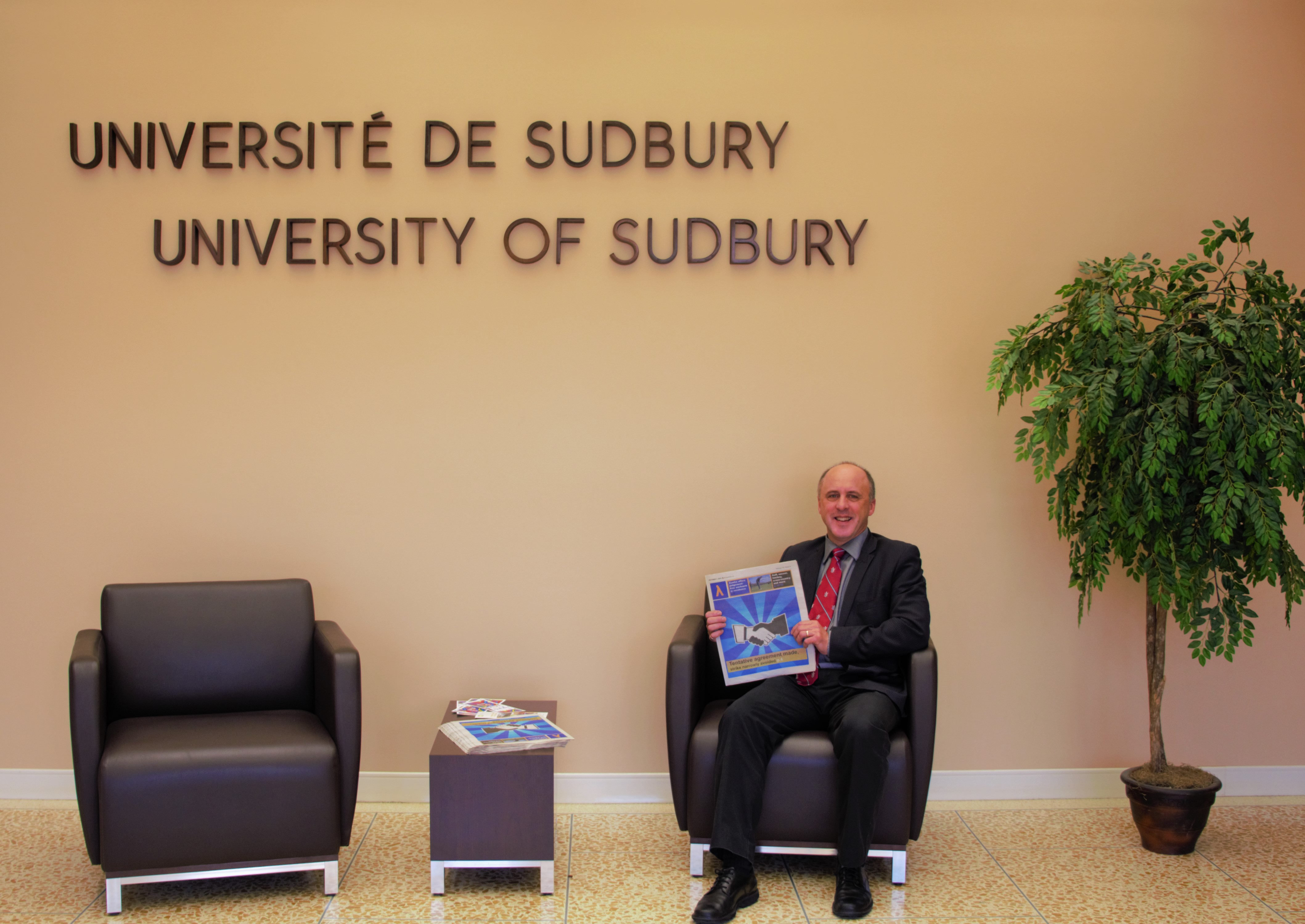 Pierre Zundel, President and Vice-Chancellor of the University of Sudbury, sits in the buildings lounge. Photo by Zara Golafshani.