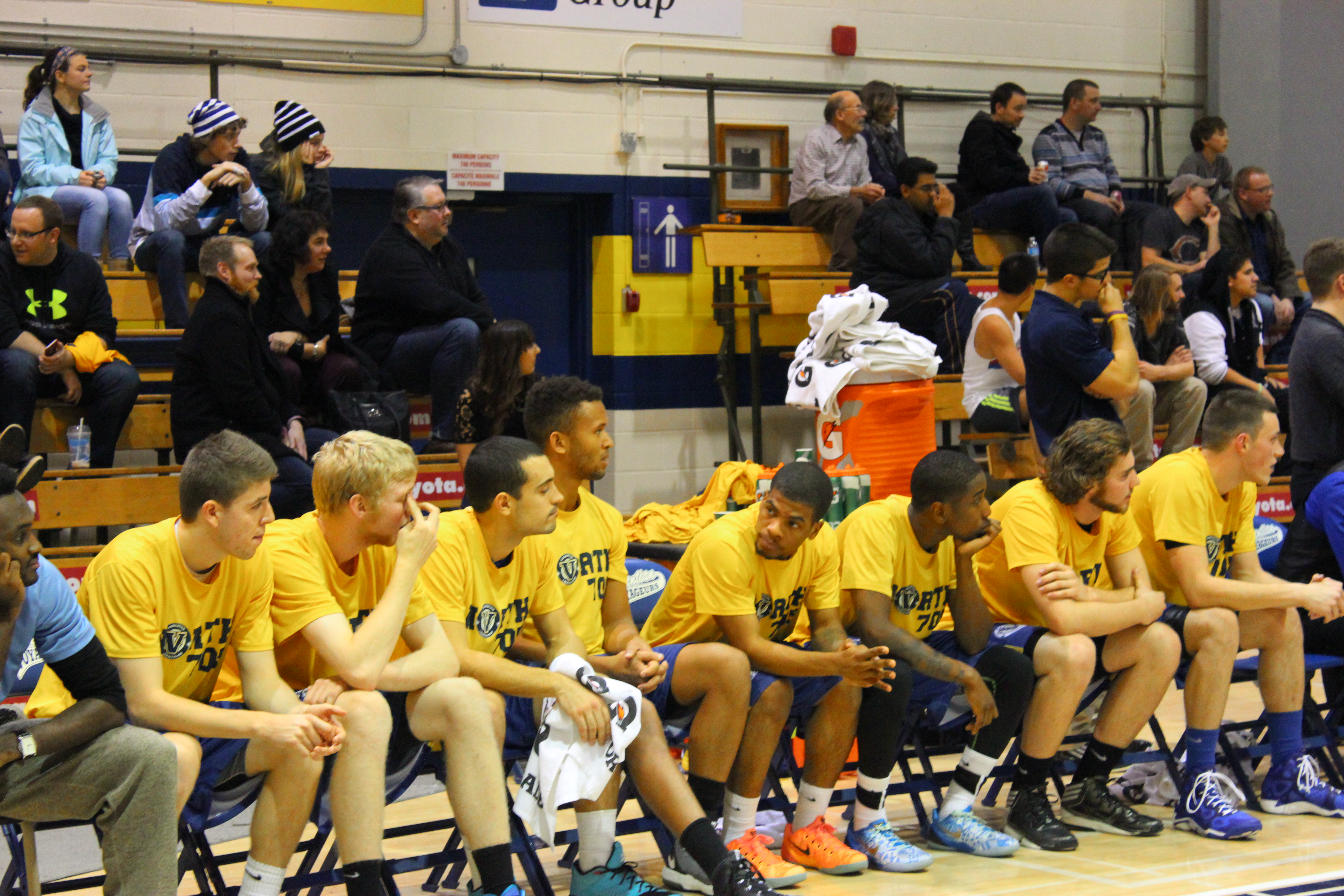 Members of the Laurentian men's basketball team watch during the game. Photo by Anthony Crozzoli