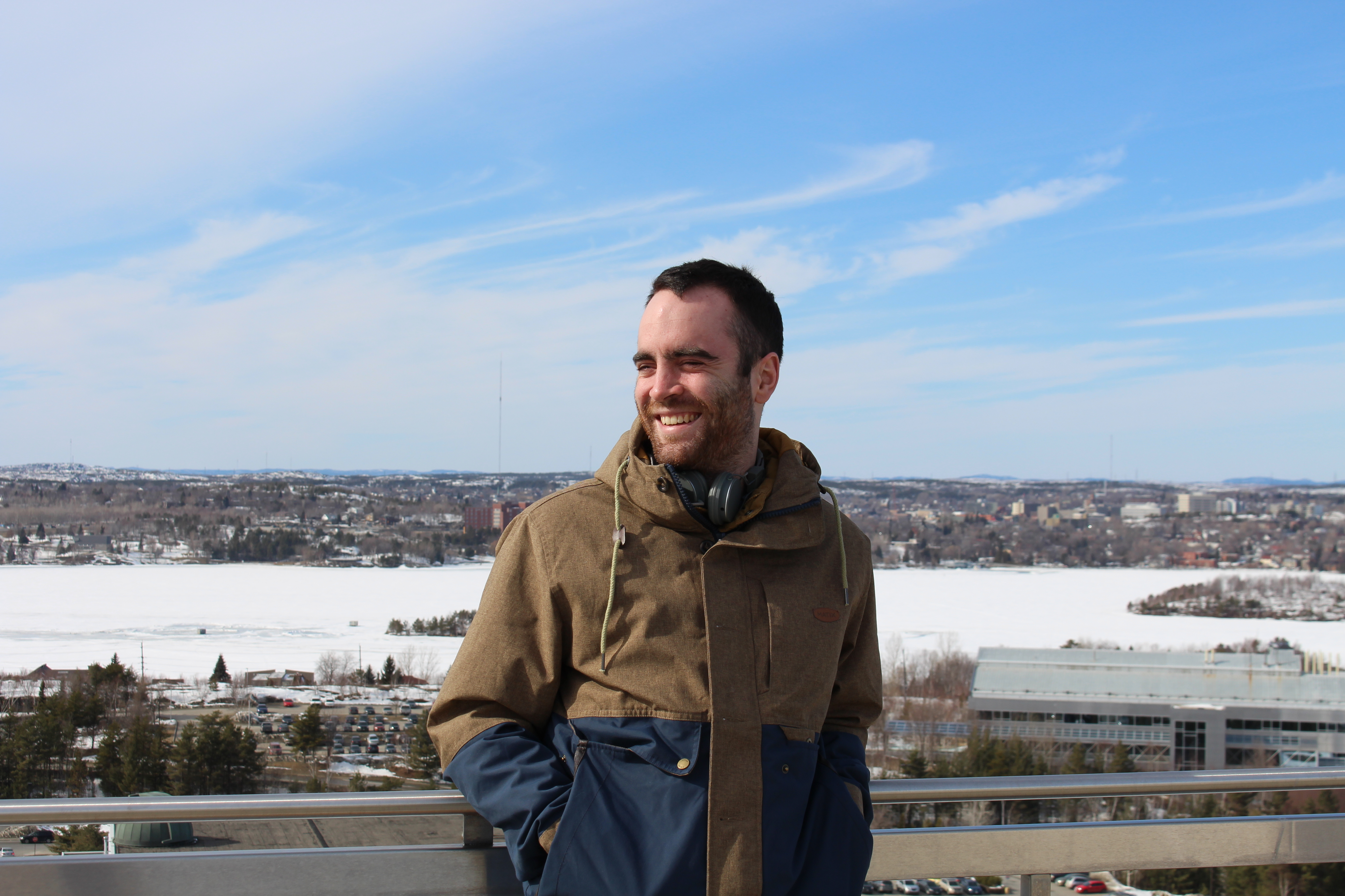 Iain Park poses atop the Parker building on Laurentian University campus. Photo by Kayla Perry